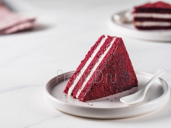 Piece of red velvet cake with perfect texture